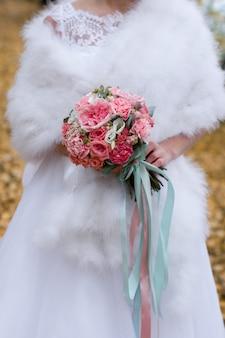 Bouquet of flowers in hands of bride. wedding