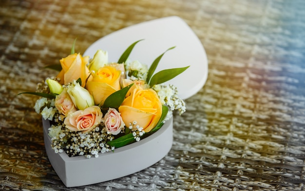 Bouquet of flowers in old wooden rustic box