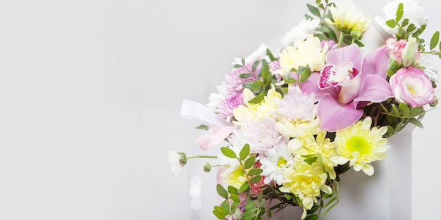 Bouquet of flowers - orchids and chrysanthemums.