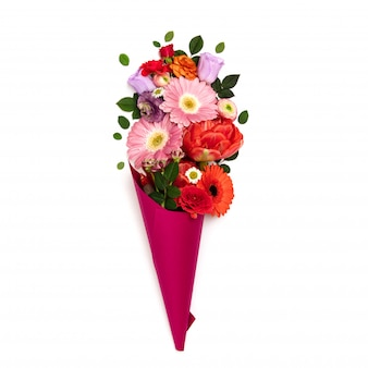 Bouquet of flowers in paper cone on white