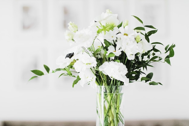 Bouquet of flowers in vase and home decor details luxury interior design closeup