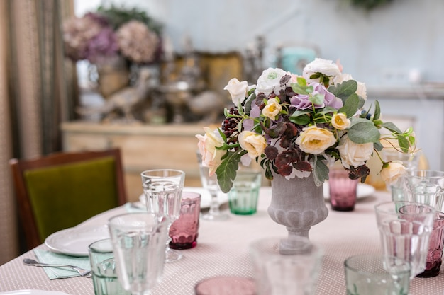 Bouquet of flowers in a vase at the wedding table
