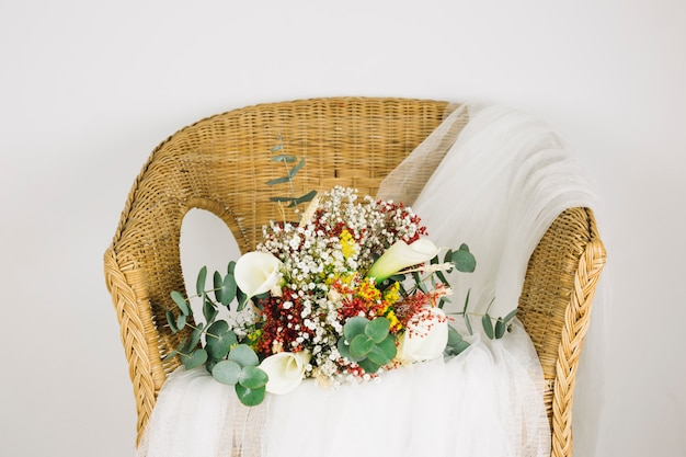 Bouquet of flowers with bridal veil