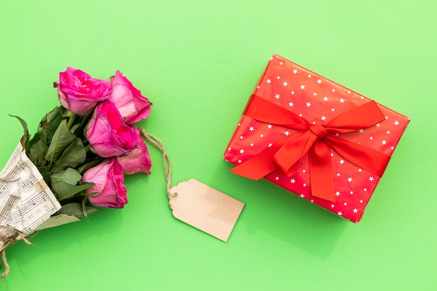 Bouquet of flowers with label and gift