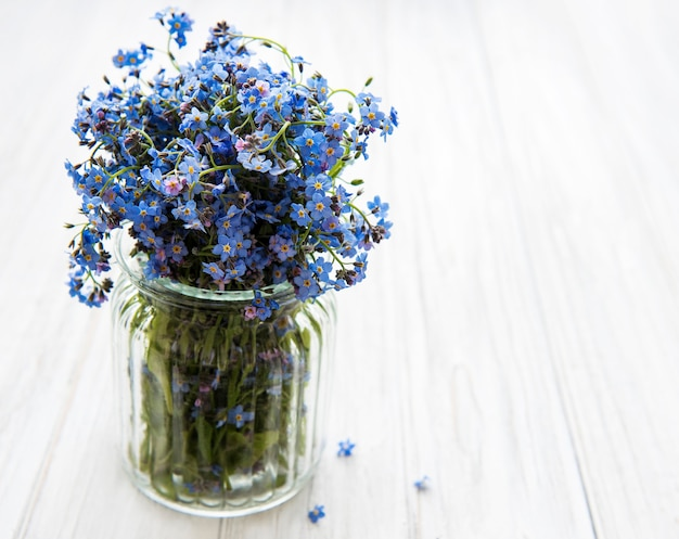 Bouquet of forget me not flowers in the glass vase