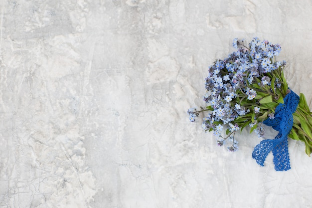 A bouquet of forget me nots and lace ribbon