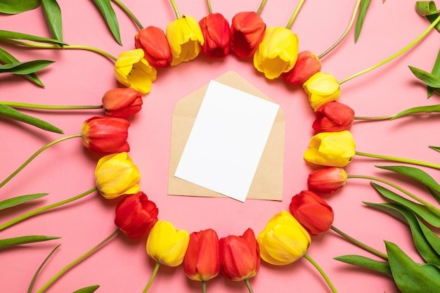 Bouquet of fresh and bright flowers frame on red background