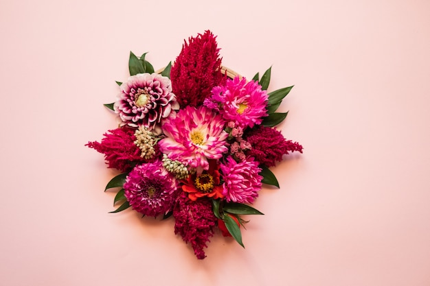 Bouquet of fresh flower in the center of a pink background