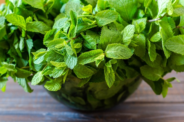 Bouquet of fresh mint in a glass bowl