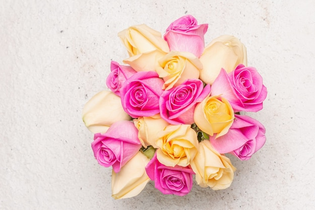 Bouquet of fresh multicolored roses in a vase. the festive concept for weddings, birthdays, march 8th, mother's, or valentine's day. greeting card, light background