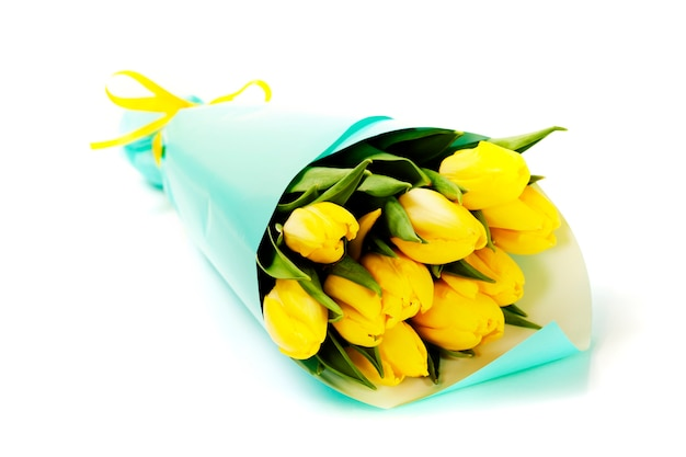 Bouquet of fresh yellow tulips on white background