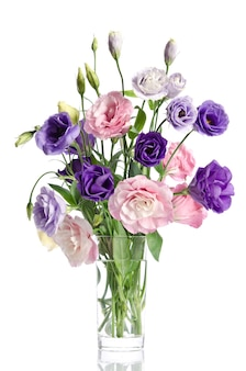 Bouquet from beautiful eustoma flowers with leafs and buds on white