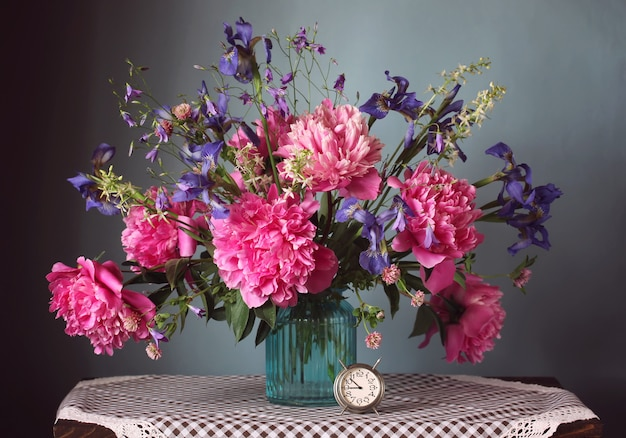 Bouquet of garden and wild flowers in a vase