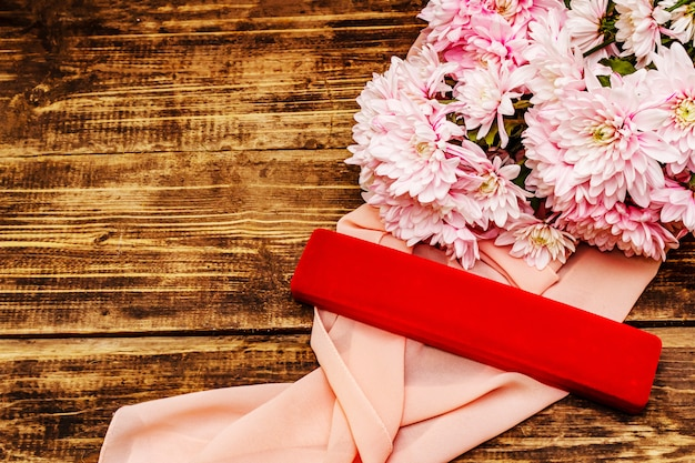 Bouquet of gently pink chrysanthemums. beautiful gift on vintage wooden background