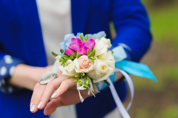 Bouquet on his hand bridesmaids