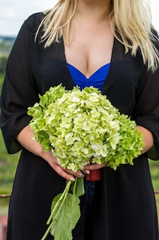 Bouquet hydrangea in the hands