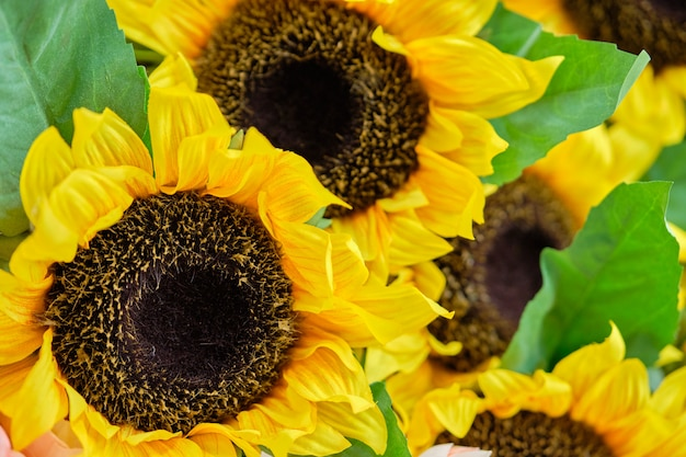 Bouquet of juicy artificial sunflowers.
