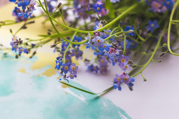A bouquet of lavender blue flowers on a light background top view