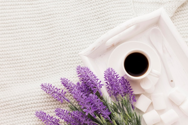 Bouquet of lavender and cup of coffee