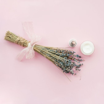 Bouquet of lavender flowers and body cream