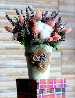 Bouquet of lavender, pink flowers, fir branches, hazelnuts and c