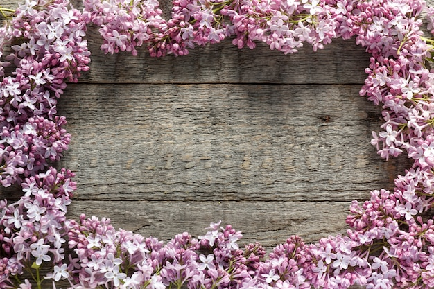 Bouquet of lilac flowers on wooden background. copy space.