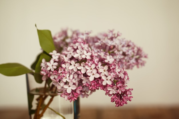 Bouquet of lilac spring flowers on wooden background.