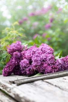 Bouquet of lilac on a wooden background. copy space