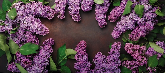 A bouquet of lilacs with chalk board on rusty background. top view with place for your text. mother's day.