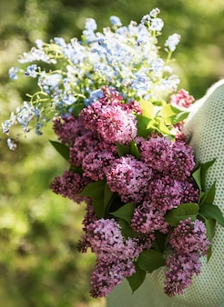 Bouquet of lilacs in woman hands