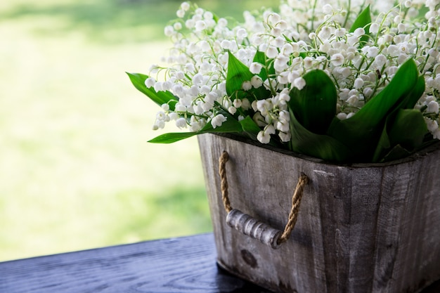 Bouquet of lilies of the valley in a basket.