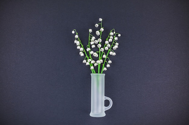 Bouquet of lilies of the valley on black