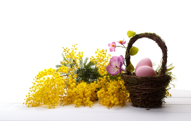 Bouquet of mimosa and easter eggs