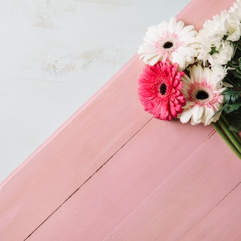 Bouquet of flowers on pink