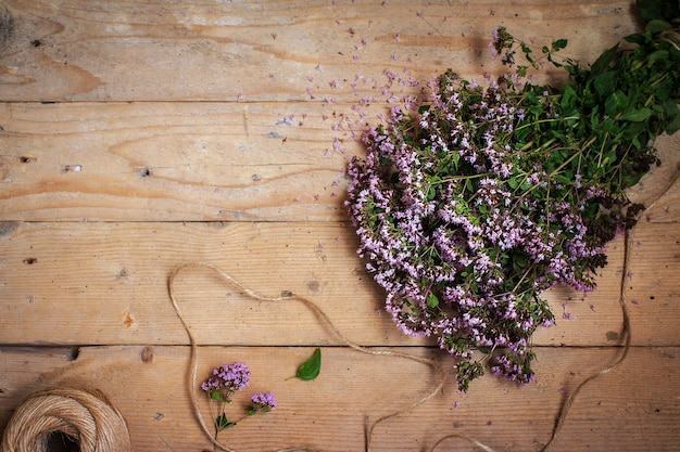 Bouquet of oregano marjoram on  wooden table