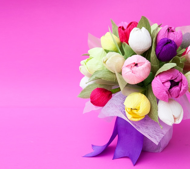 A bouquet of paper tulip flowers on pink