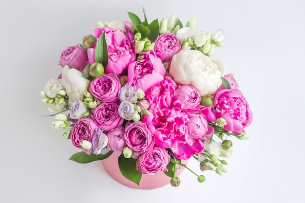 Bouquet of peonies, eustoma, spray rose in a pink box