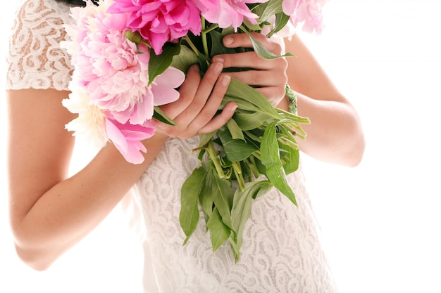 Bouquet of peonies in woman's hands