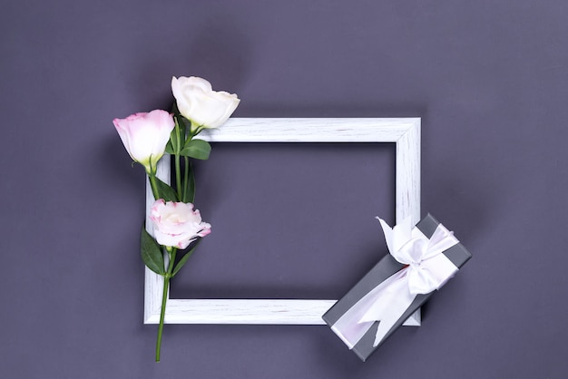 Bouquet of pink eustoma flowers with gift box and frame