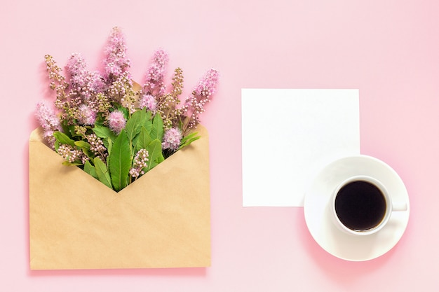 Bouquet of pink flowers in envelope
