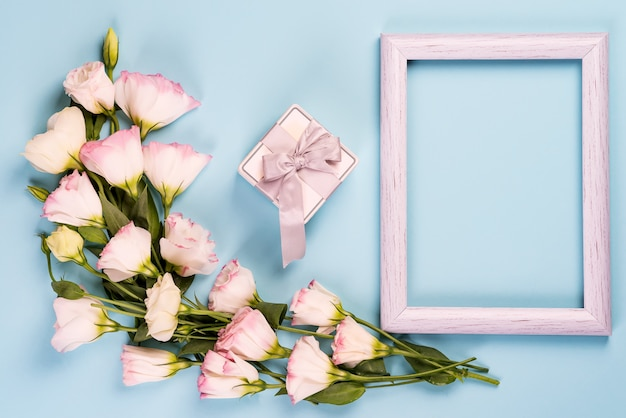 Bouquet of pink flowers eustoma with gift box and frame