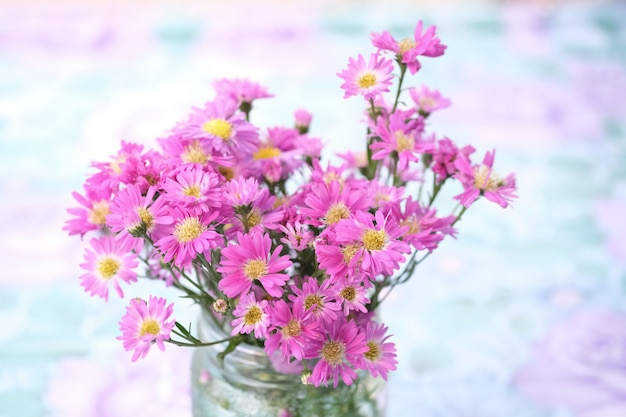 Bouquet of pink flowers in glass vase