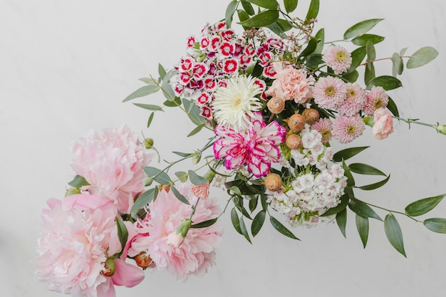 Bouquet of pink flowers on white background