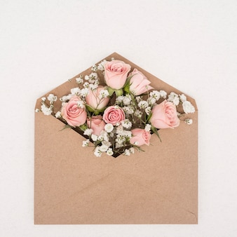 Bouquet of pink roses in an envelope
