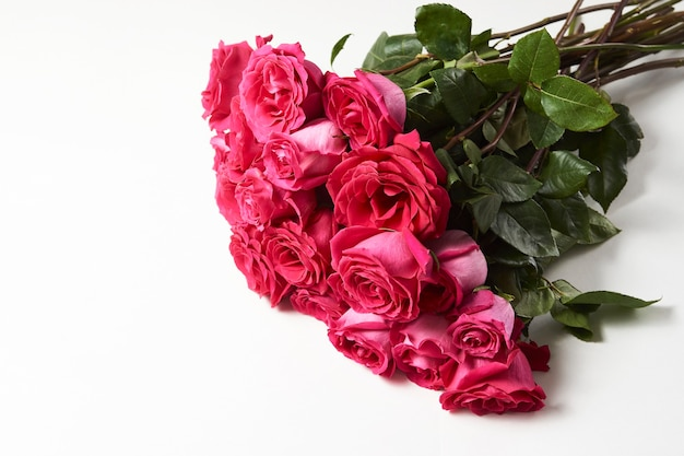 Bouquet of pink roses on white background with copy space.