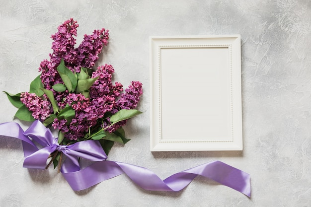 Bouquet of purple lilac flowers with frame and space for text