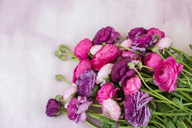 A bouquet of ranunculus and free space for text