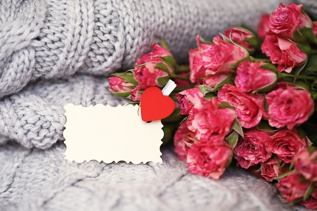 Bouquet of red roses on a textile sweater