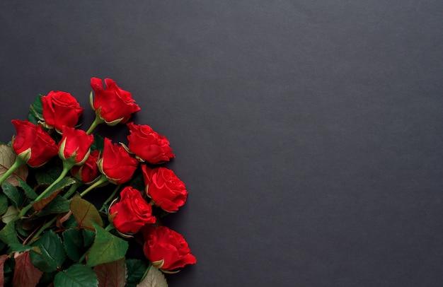 A bouquet of red roses with on a black background