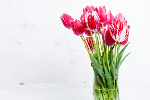 Bouquet of red tulips in a vase